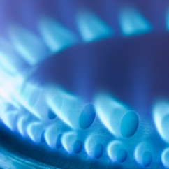 Blue flames of a gas stove in the dark